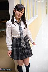 Student In Corridor Wearing Uniform