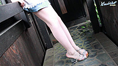 Wearing Short Denim Skirt In High Heels