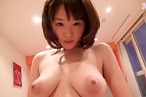 Breasty cutie Mao eating banana nude on bed