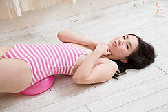 Lying On Floor Wearing Pink Striped Swimsuit