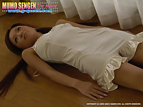 Yua Ando lying on her back wearing cream slip