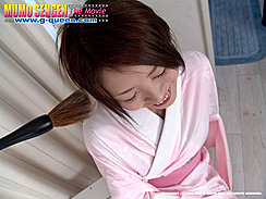 Smiling At Brush Tickling Her Ear In Pink Belted Kimono