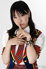 Momoko Miura Finger Raised To Lips Long Hair Down Over Her Shoulders Wearing White Whirt Plaid Tie And Skirt