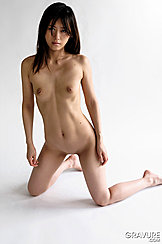 Kneelingon Floor Arms Down At Her Sides Small Boobs Exposed Shaved Pussy Between Her Slightly Parted Thighs
