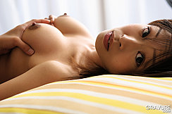 Lying On Her Back Head On Striped Pillow Holding Her Breasts Erect Nipples