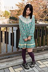 Standing In Garden Wearing Dress Hands Together At Her Waist Wearing Socks