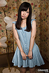 Standing In Gingham Dress Long Hair Hands At Her Front