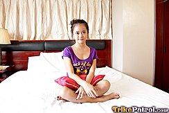 Cute Filipina Mitch Sitting Cross Legged On Bed Wearing Purple Tshirt Forearms Crossed