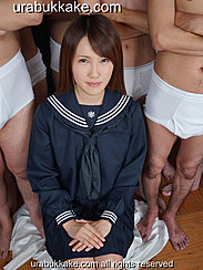 Kogal Seated Before Half Naked Men Wearing Uniform Hands Clasped Together On Her Lap