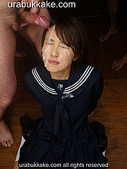 Natsumi Seated On Floor Man Cumming Over Her Face Cum Running Down Her Cheeks